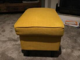 Yellow fabric footstool