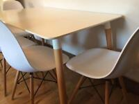 Contemporary white dining table with 4 Eames style chairs, great condition