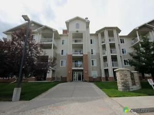 $309,000 - Condominium for sale in Country Hills Village