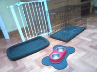 Just what you need for a new puppy. Training crate, bed, bowls & safety gate