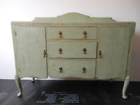 Green sideboard/chest of drawers.