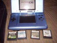NINTENDO DS LIKE NEW WITH GAMES AND CASE AND CHARGER