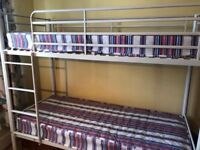 White metal bunk beds and mattresses
