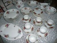 40 PIECE DINNER/TEA SET YELLOW/ REDROSE PATTERN