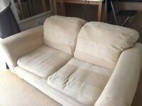 2 Seater cream fabric patterned sofas - 2 identical sofas available