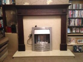 Marble fireplace with wood surroundings and electric fire