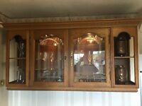 Solid Oak Kitchen Display Cabinet. Spot lights and glass shelves. Corner display shelves.