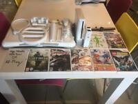 WII Console 2 Controllers and Nunchucks, Fitness Board, and 8 Games. Excellent condition.