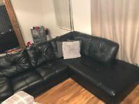 Beautiful new - barely used black leather corner sofa
