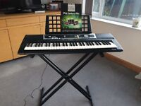 Yamaha electric keyboard and stand. Has 61 regular sized keys plus many different sounds and beats.
