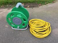 Brand new hose reel and approx 10m hose