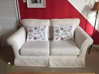 Cream sofa and two chairs
