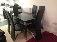 EXTANDABLE BLACK GLASS STRONG DINNING TABLE WITH SIX BLACK STEEL LEATHER VERY STRONG