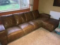 Large 4 seater tan (upgraded) leather sofa and puffy ONO