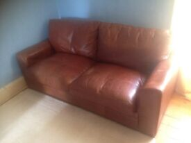 Brown leather 2 seater sofa bed. Excellent condition!