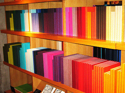 Coloured books can be a bright part of a feature wall