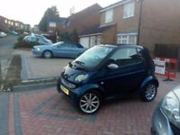 2005 black smart auto convertible with air con