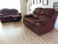 Two x 2 seater brown leather (suede) recliner sofas leather excellent condition.