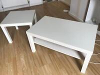 Two white Ikea tables