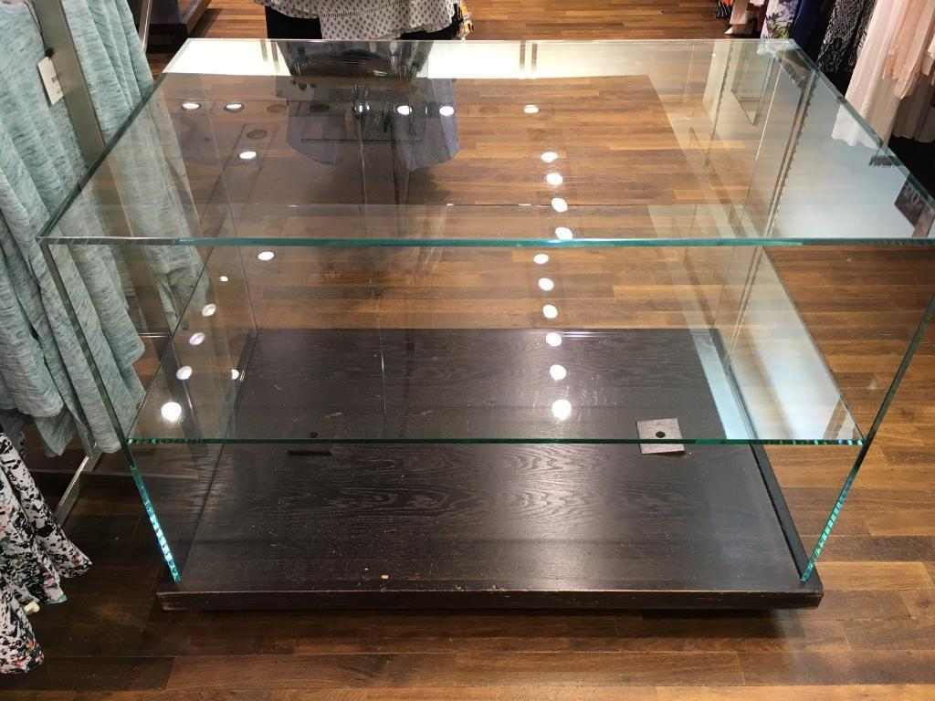 Retail glass display unitin Derby, DerbyshireGumtree - Glass unit on wheels, 2 shelves with wooden base.Length 122cmWidth 74cmHeight 93cm 2 available price is per unit