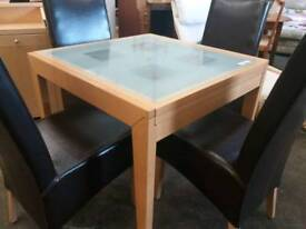 Glass top extending table with 4 leather chairs