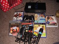 PLAYSTATION 2 WITH MICS AND GAMES