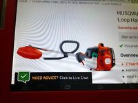 PETROL STRIMMER as new