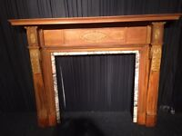 Antique Pine Fireplace with marble interior .