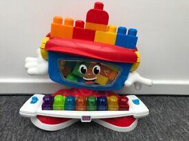 £2. MEGA BLOCKS musical toy and bricks.