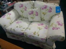 Unique floral reupholstered 2 seat sofa