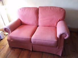 2 seater cloth covered sofa.