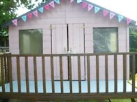 LOVELY CHILDRENS WOODEN PLAYHOUSE AND SLIDE