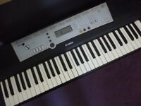 yamaha E 203 full size digiital light weight keyboard,has various voices,styles mains power supply..