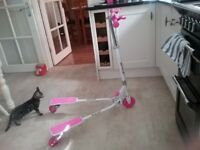 Girls pink scooter as new good Christmas present
