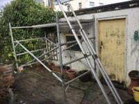 Aluminium tower with 2 outriggers for sale