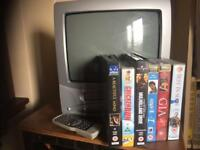 Vintage TV and video recorder with selection of VHS movies