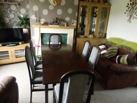 Dark Oak Dining Table with 6 upholstered chairs