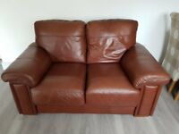 3 piece suite: Brown leather 2 seater sofa, single armchair and footstool. Immaculate condition.