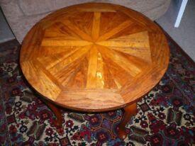 small circular wooden table