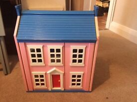 Charming Dolls House complete with family and furniture