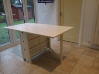 Folding Kitchen table. Adjutable to sit 2-4.