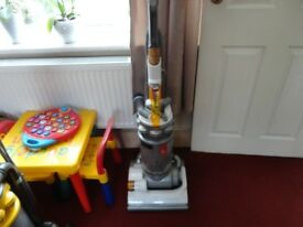 white and silver dyson hoover in good working order