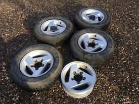 Five alloyed wheels and four winter tyres 205/70r15.