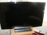 "PANASONIC 42"" TELEVISION FINISHED IN PIANO BLACK SURROUND WITH FREEVIEW £12O COULD DELIVER."