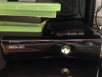 Xbox with 2 remotes. Still work perfect black
