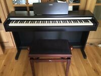 Yamaha YDP-142 Piano with adjustable piano stool