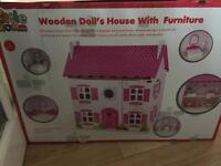 Brand new wooden doll house with furniture