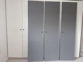 3 grey ikea meraker wardrobe doors