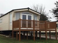 The amazing Atlas Status with decking and central heating on 4* 11 month park.