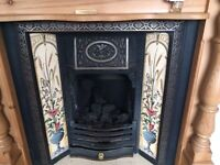 Beautiful Vintage Cast Iron Tulip Gas Fireplace with hand painted tiles and pine surround.